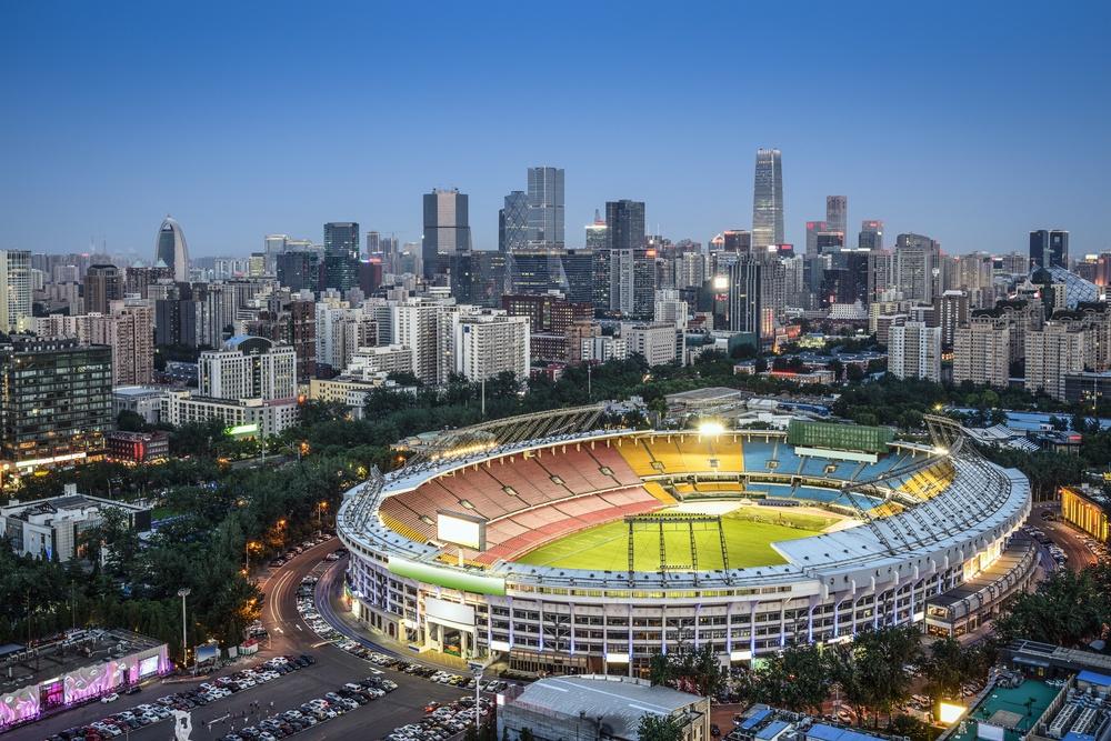 Beijing, China skyline and stadium.