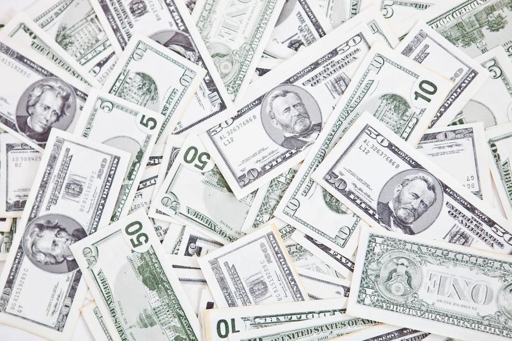 Closeup to a bunch of dollar bills - money concepts.jpeg